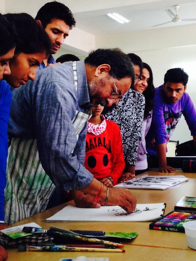 Students learning sketching by renowned artist Mr. Ravinder Sharma